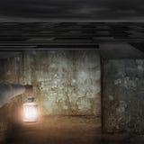 Hand holding vintage lamp illuminated dark maze entrance Stock Photography