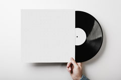 Hand holding vinyl music album template on white Royalty Free Stock Image