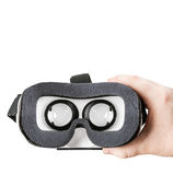 Hand holding virtual glasses on a white background Royalty Free Stock Image
