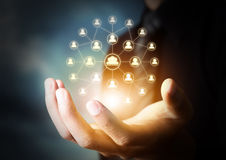 Hand holding virtual icon of social network Stock Photography