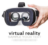 Hand holding virtual reality glasses stock photography