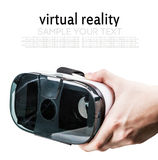 Hand holding virtual reality glasses on white backgroun royalty free stock photos