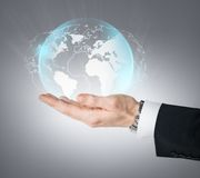 Hand holding virtual sphere globe. Technology, news and environment concept - man hand holding virtual sphere globe Stock Photography