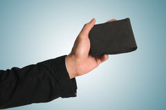 Hand holding wallet Royalty Free Stock Photos