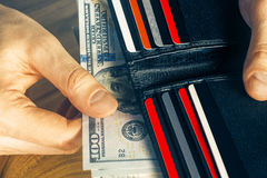 Hand holding wallet Royalty Free Stock Images