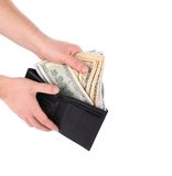 Hand holding wallet with dollar bills. Stock Photos