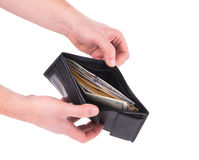 Hand holding wallet with dollar bills. Royalty Free Stock Image