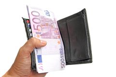 Hand holding a wallet with euro banknotes Royalty Free Stock Images