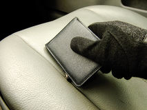 Hand holding Wallet on the Front Seat Royalty Free Stock Photos