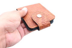 Hand holding wallet on isolated Stock Photography