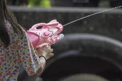 Hand holding a water gun play Songkran festival or Thai new year in Thailand royalty free stock photo