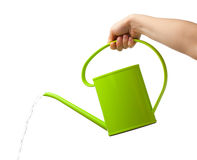 Hand holding watering can Stock Images