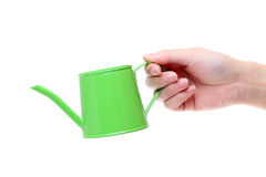 Hand holding watering can Stock Photo