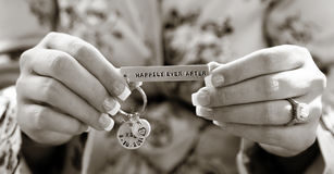 Hand holding wedding charm Royalty Free Stock Photos