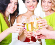 Hand holding wedding glass with champagne. Royalty Free Stock Photography