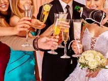 Hand holding wedding glass Stock Photo