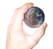 Hand holding West globe with face reflection Stock Photo