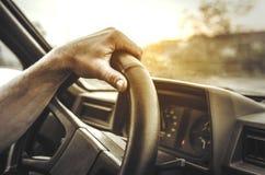 Hand holding the wheel. Royalty Free Stock Photo