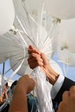 Hand holding white ballons Royalty Free Stock Photos