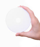 Hand holding white blank cd dvd disc. Isolated hand holding white blank cd dvd disc Royalty Free Stock Photography