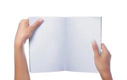 Hand holding white blank magazine stock images