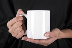Hand Holding White coffee cup. mock up for creative design brand stock images