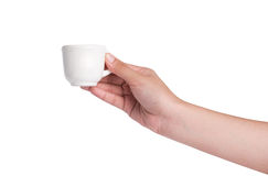 Hand holding a white cup of tea Royalty Free Stock Images