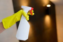 Hand holding white detergent spray bottle Royalty Free Stock Photography