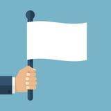 Hand holding white flag Stock Photo