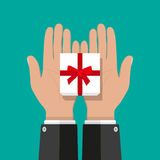 Hand holding white gift box with red bow. Businessman hands holding white gift box with red bow. vector illustration in flat style Stock Images