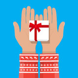 Hand holding white gift box with red bow Stock Photo