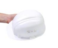 Hand holding white hard hat. Stock Photography