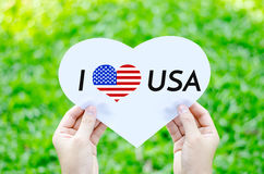 Hand holding white heart paper with I love USA text Royalty Free Stock Photography