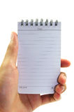 Hand holding white notebook. On white background Royalty Free Stock Image