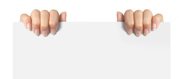 Hand holding a white paper Stock Photos