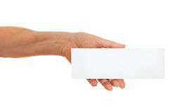 Hand holding white paper, cardboard.  Royalty Free Stock Image