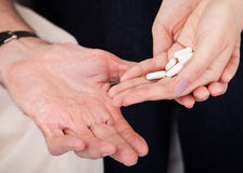 Hand Holding White Pills Stock Photography