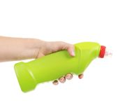 Hand holding white plastic bottle. Stock Photos