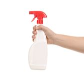Hand holding white plastic spray bottle Stock Photos