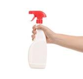 Hand holding white plastic spray bottle Stock Photos