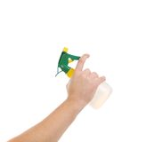 Hand holding white plastic spray bottle Royalty Free Stock Photo
