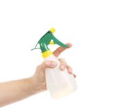 Hand holding white plastic spray bottle. Stock Photo