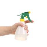 Hand holding white plastic spray bottle. Stock Images