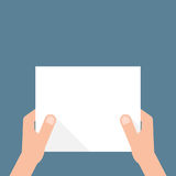 Hand holding white sheet of paper Royalty Free Stock Photo