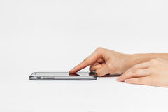 Hand holding white smart phone, playing games Stock Photos