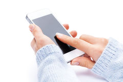 Hand holding White Smartphone with blank screen on Stock Photo