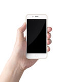 Hand holding the white smartphone. Hand holding White Smartphone with blank screen on white background stock image