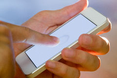 Hand holding a white smartphone. In close up Stock Images