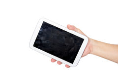 Hand holding white tablet computer with fingerprint dirty screen.  royalty free stock photo