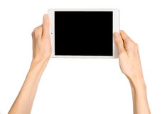 Hand holding a white tablet touch computer  Royalty Free Stock Images